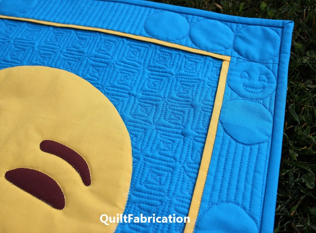 smiling face in the upper quilt corner