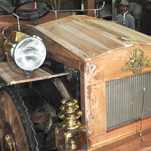 Tinuku Wiyanta craftsmen build luxury classic car made teak wood and engined Toyota Kijang 1990s