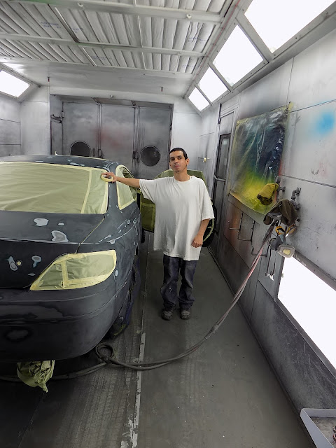 Paintline Technician preparing a vehicle for paint.