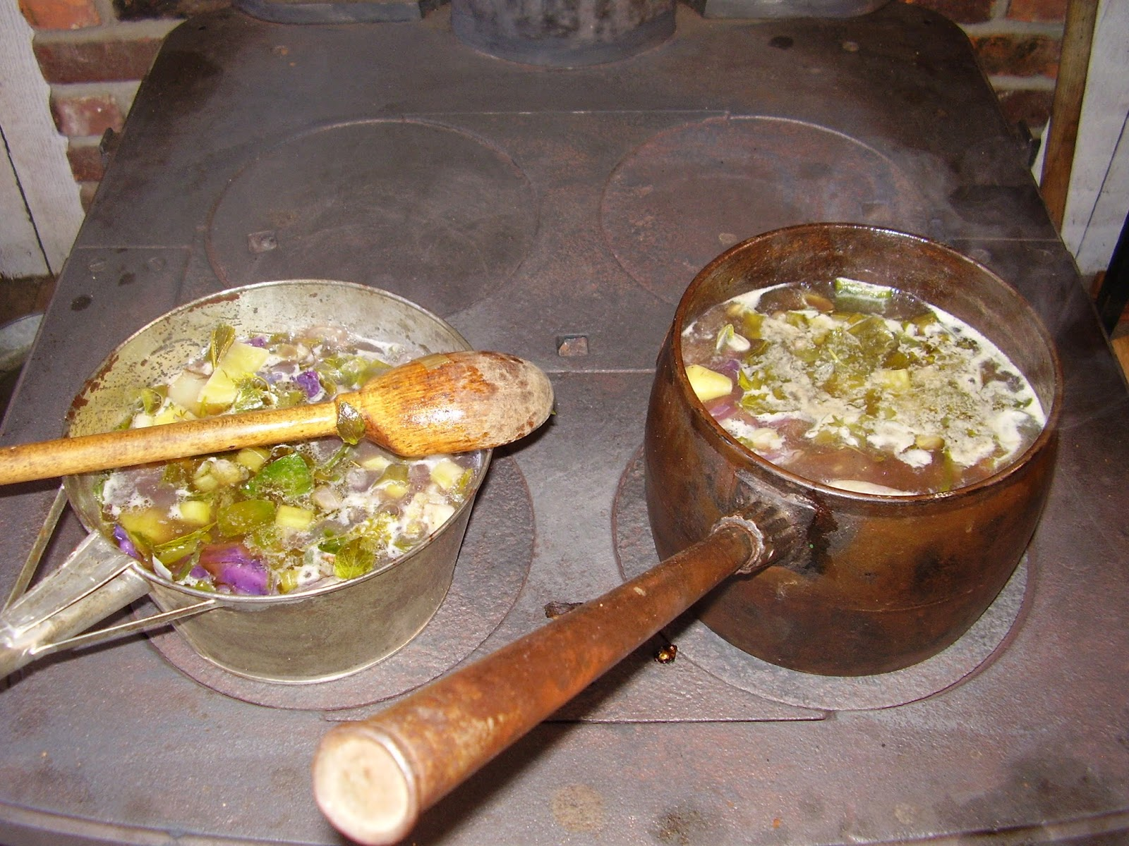 Soup cooking on wood-burning stove.