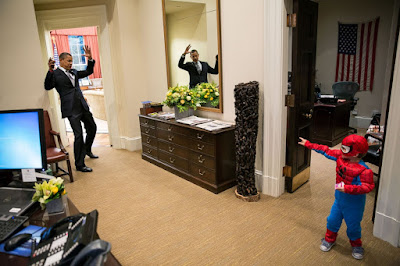 President Obama plays the villain with Nicholas Tamarin, a three-year-old Spider-Man, just outside the Oval Office on October 26, 2011. Photo Pete Souza.