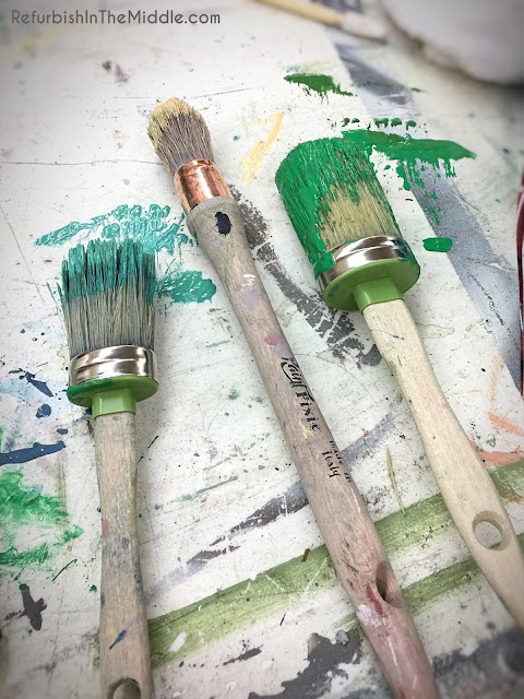 paint pixie brushes dipped in shades of green paint