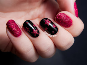 Textured ruby stars by @chalkboardnails