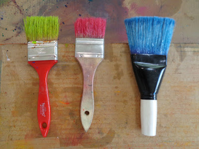 brushes with bright colours oil paint