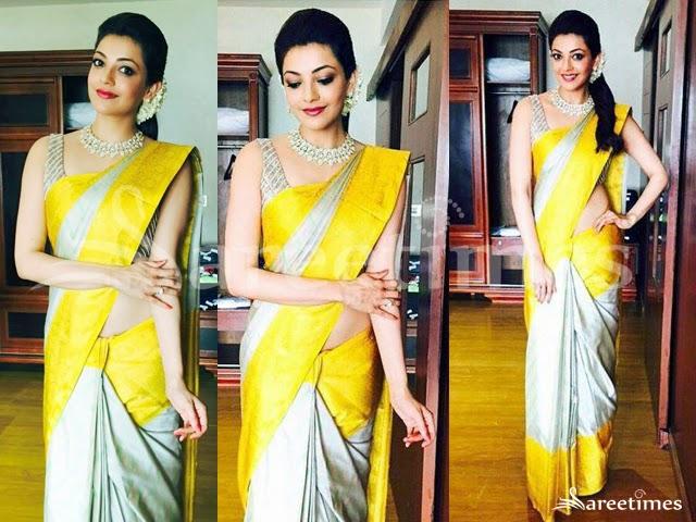 90d9d6d3a83 Kajal Agarwal at Malabar Gold store inauguration in a silver color Gaurang  Shah kanjeevaram saree featuring yellow border paired with silver  sleeveless ...