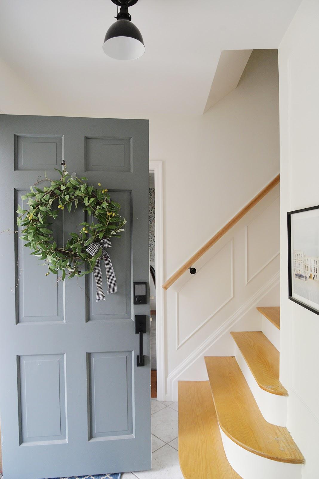olive wreath on a front door, smart front door lock, grey green painted door