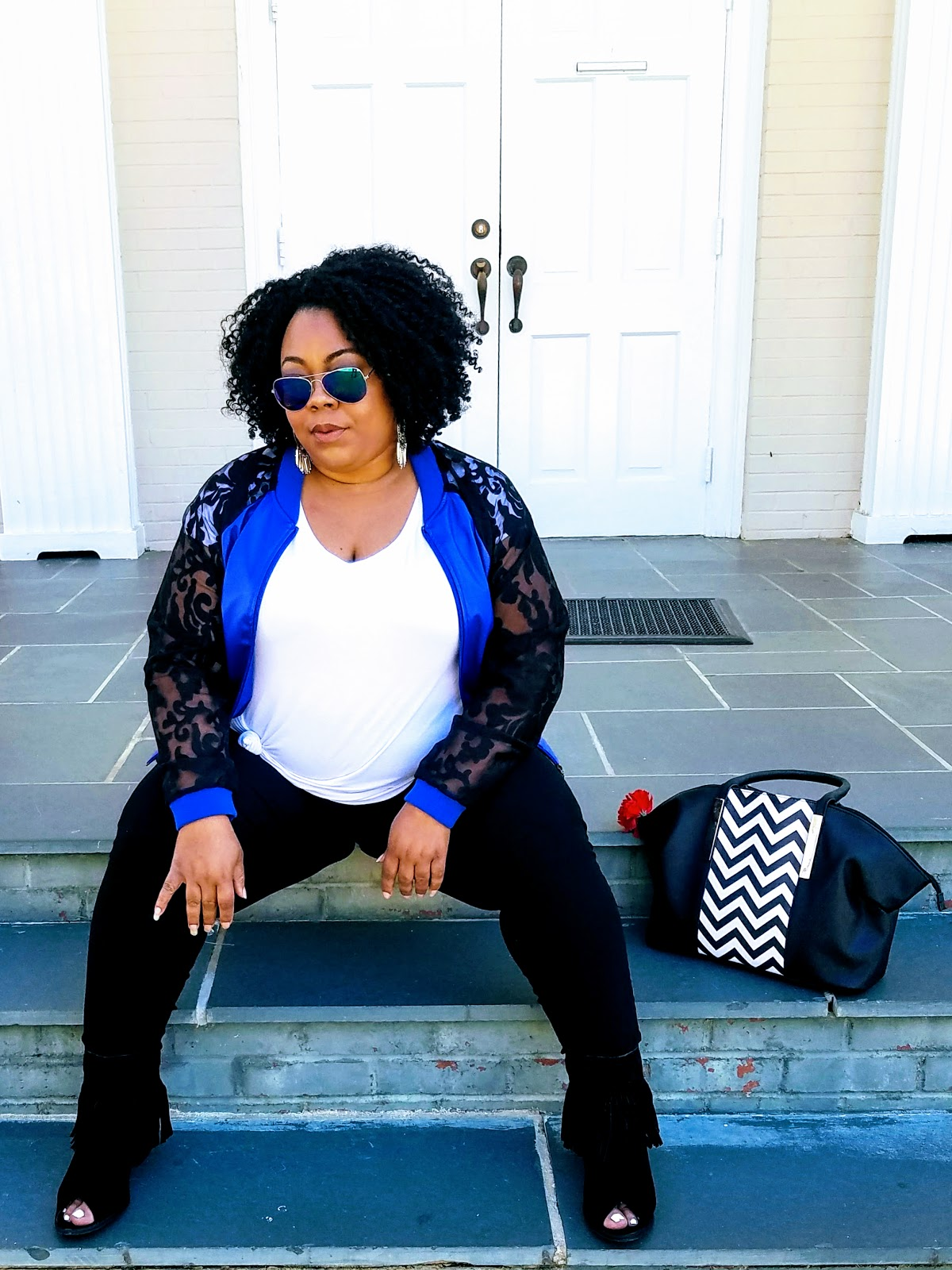 plus size, curvy girl, bomber jacket, floral print, fringe booties, natural hair, skinny jeans, aviator glasses