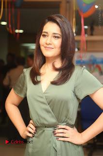 Actress Raashi Khanna Stills in Green Short Dress at Mirchi 95 Suno Aur Mercedes Jeeto Contest  0059.JPG