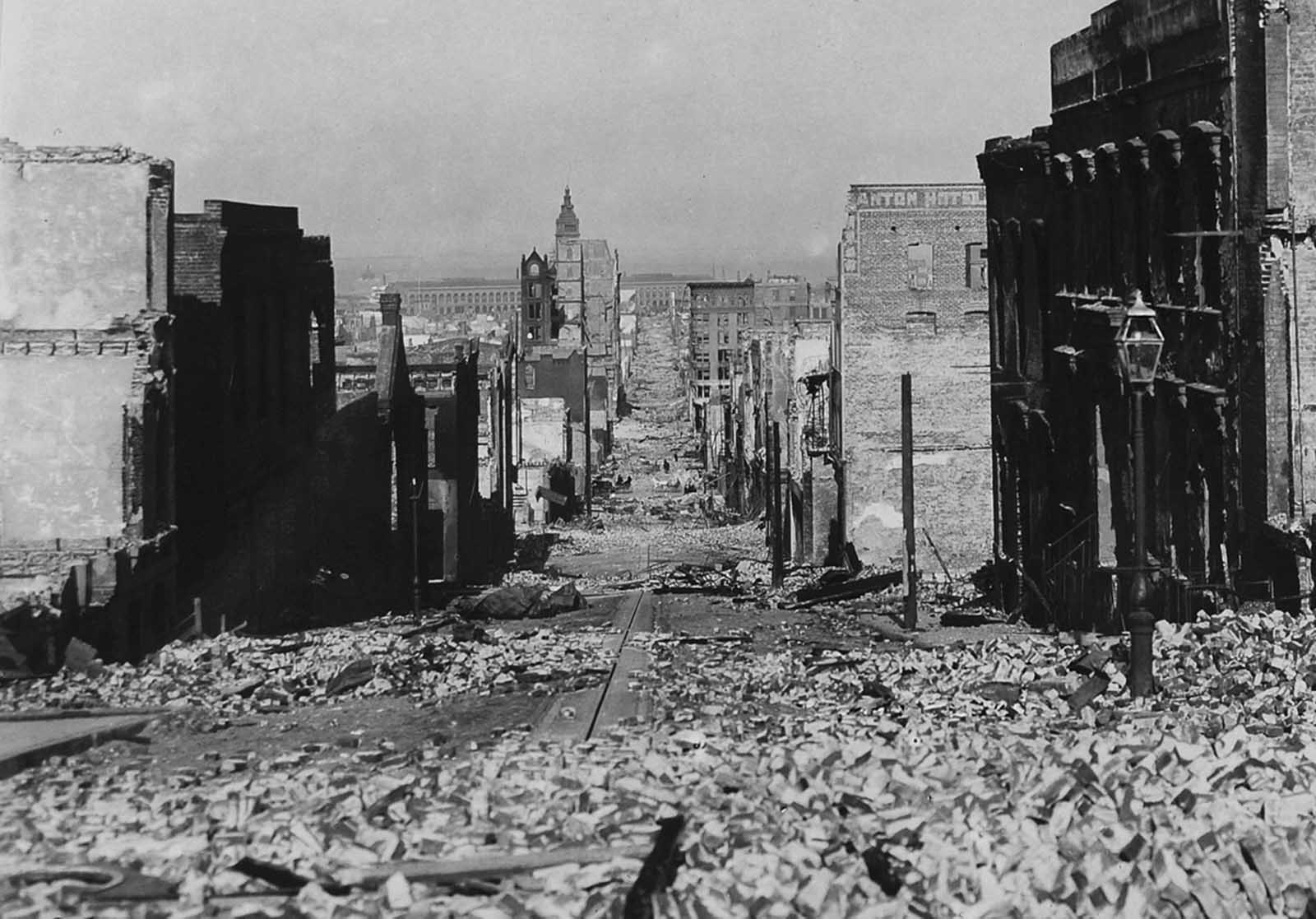 After the disaster, looking down Sacramento Street, from Nob Hill, with the Ferry Building in background.
