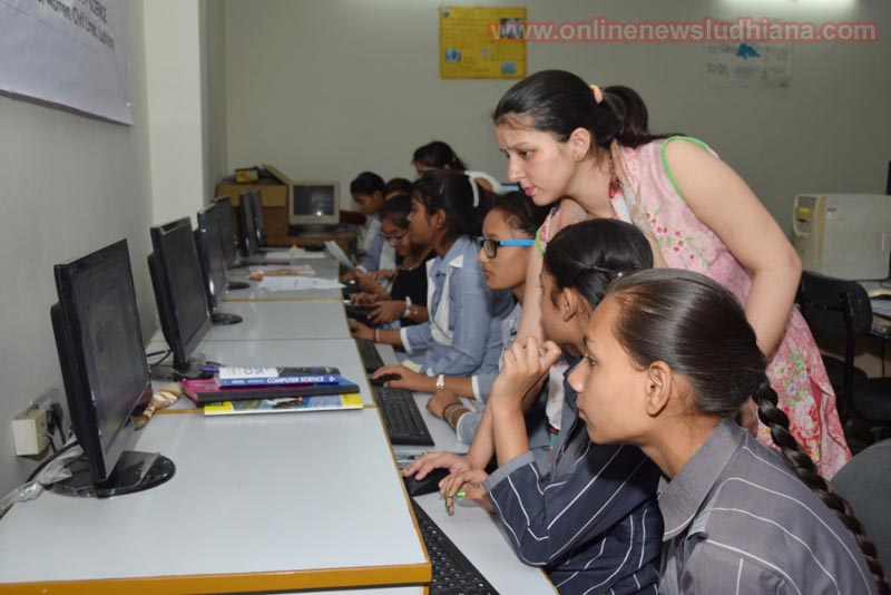 Students taking part in Computer Literacy Program for School Children organized by KCW