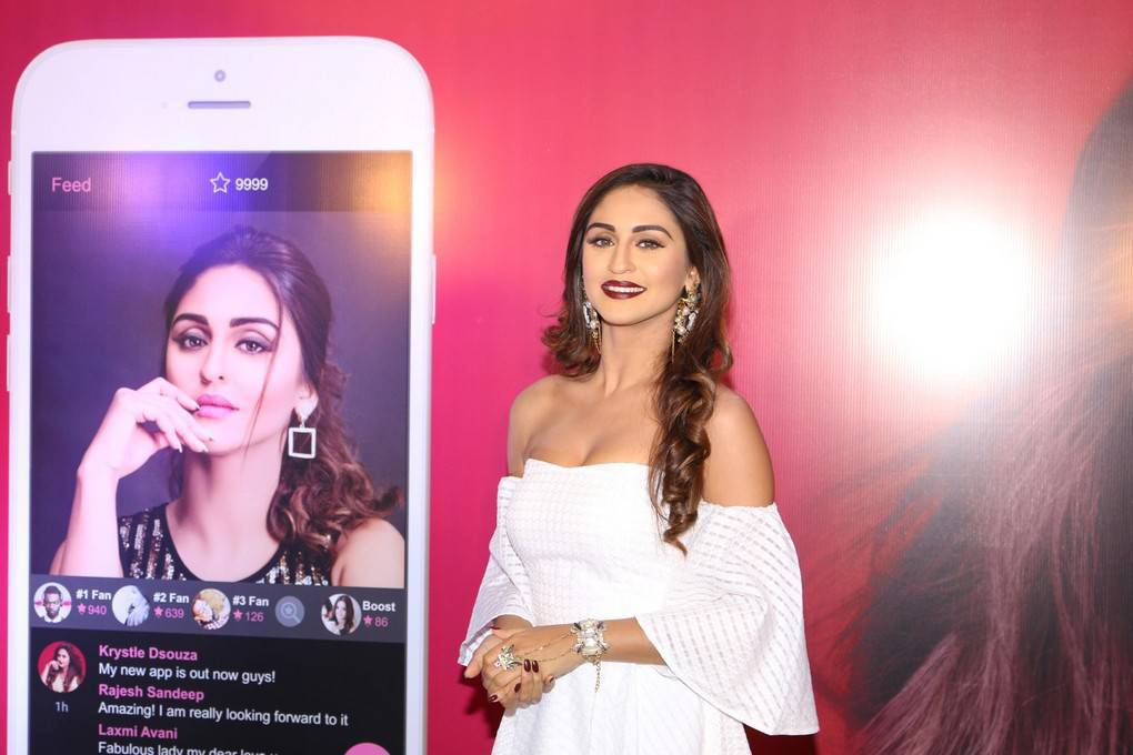 Hindi Cute Girl Krystle DSouza In White Dress At Mobile App Launch