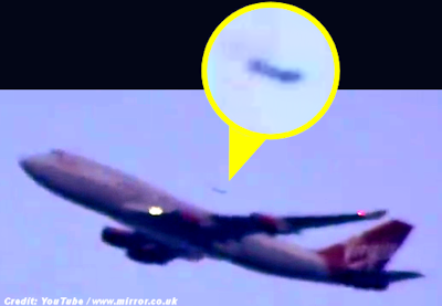Disc Shaped UFO Caught Camera Flying Past Airliner