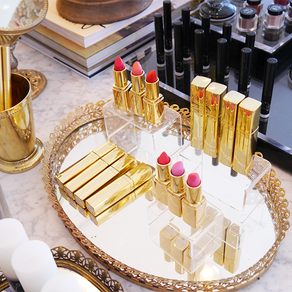 Lipsticks on a gold mirrored tray