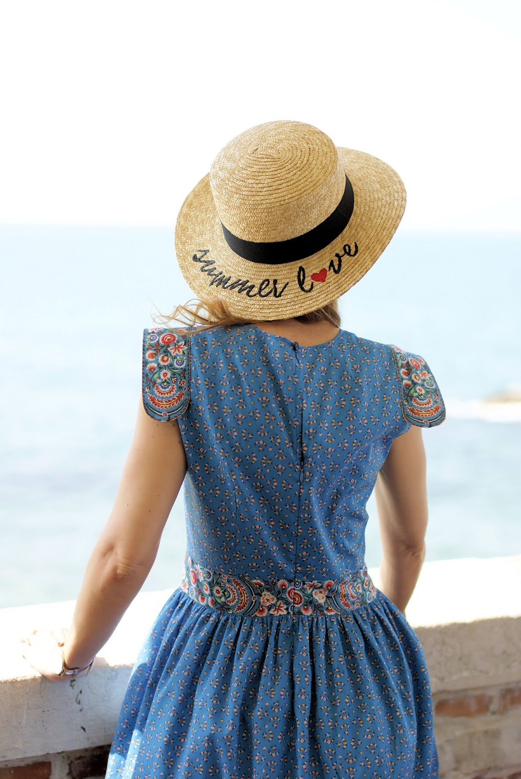 Straw hat with summer love writing on Fashion and Cookies fashion blog, fashion blogger style