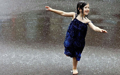adorable girl dancing in rain