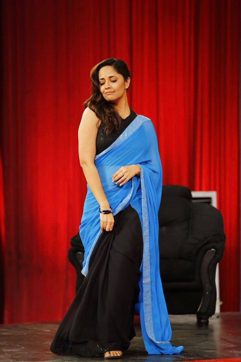 Telugu TV Anchor Anasuya Bharadwaj Long Hair Stills In Black Saree