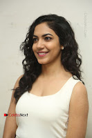 Actress Ritu Varma Stills in White Floral Short Dress at Kesava Movie Success Meet .COM 0009.JPG
