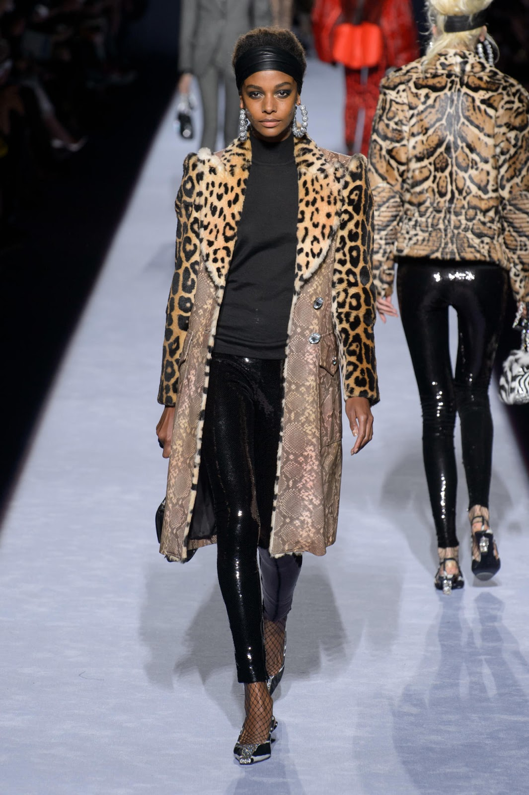bdfc09e3b277 The collection was an  80s mix of bright colors and animal prints. Models  were decked in cheetah spots