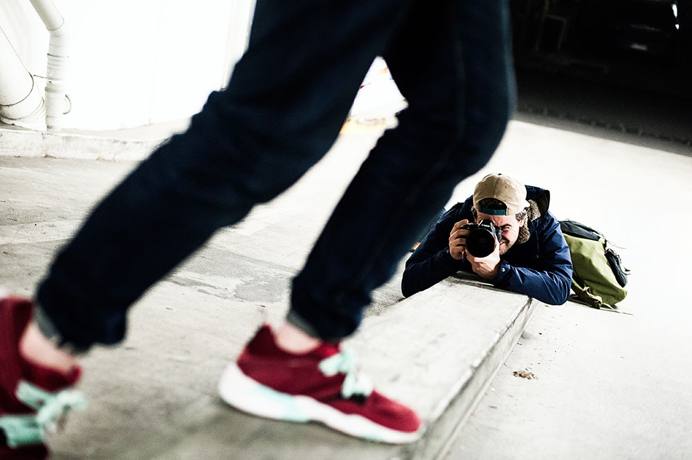 Timmy shooting Andy in his Sneaker Freaker X Packer X Puma Blaze of Glory 'Bloodbath' Sneakers by Tom Cunningham