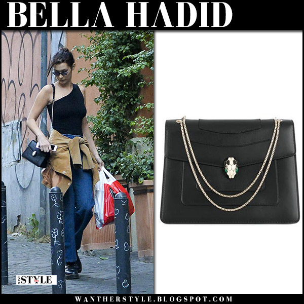 Bella Hadid in black one shoulder top, jeans and black leather bag bvlgari serpenti street fashion october 31 2017
