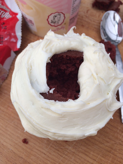 Red velvet cup cake with vanilla frosting