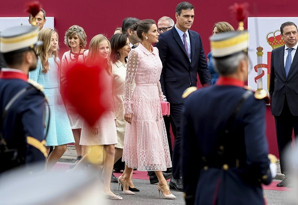Queen Letizia wore a new pink embroidered tulle midi dress by Felipe Varela. Crown Princess Leonor and Infanta Sofia