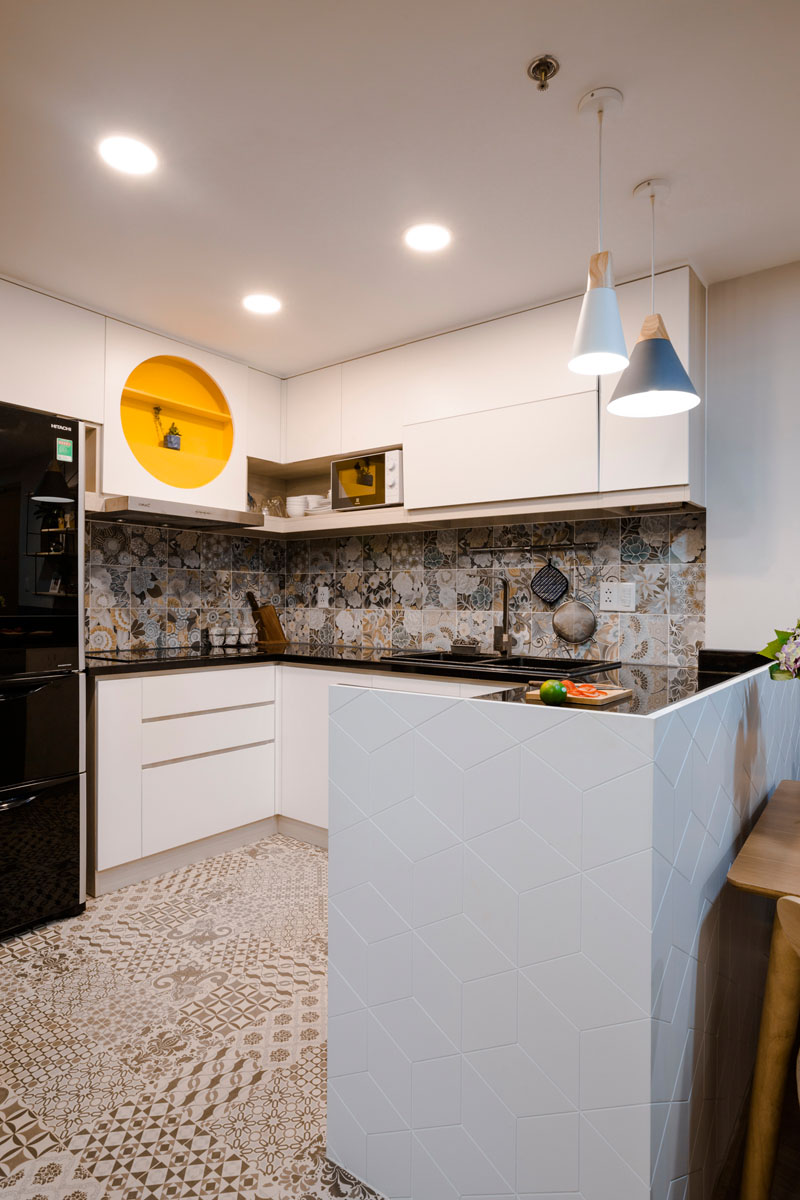 modern-white-kitchen-decorative-tiles-yellow-shelf-020518-1252-04 Fantastic Blue And Yellow Decorating Ideas Keep This Small Apartment Fun And Bright Interior