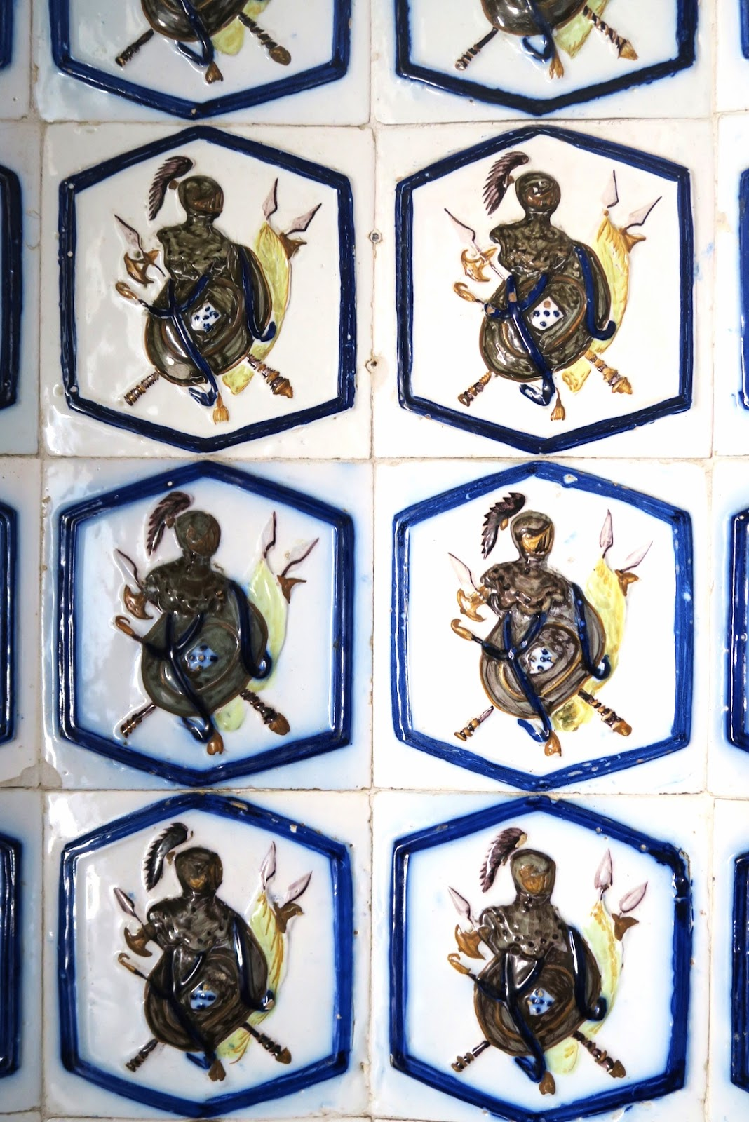 This is a close-up of beautiful tile work at the Pena Palace in Sintra Portugal.  This tile is a soldier on a horse riding with his weapon.