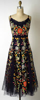 Black floral evening gown designed by Hattie Carnegie displayed on dress form