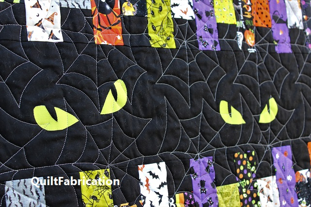 cat eyes on a quilt by QuiltFabrication