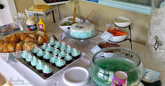 punch, water, carrots, pretzel sticks, cupcakes, cake, salad, sandwiches
