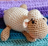 http://www.ravelry.com/patterns/library/squeezable-sheep