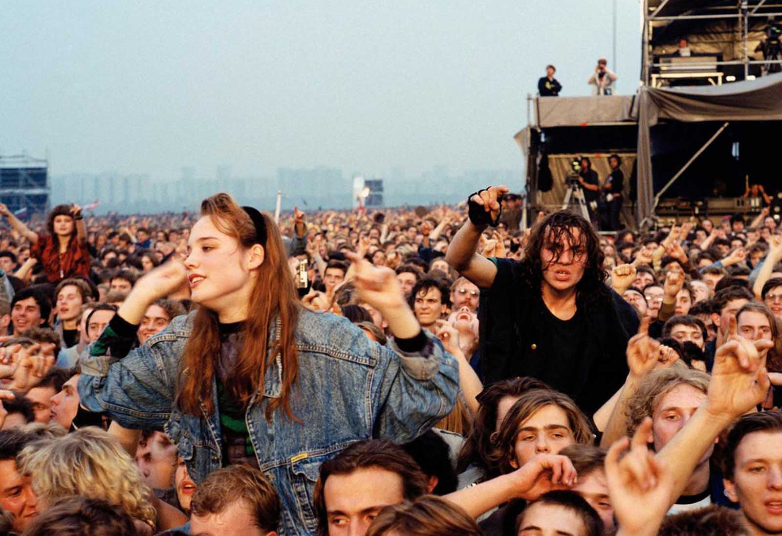 Soviet rock fans attend a concert in Moscow on September 28, 1991. Half a million people jammed an airfield to see the Monsters of Rock concert featuring AC/DC, Pantera and Metallica at the Soviet Union's biggest Western rock concert, touted as a gift to Russian youth for their resistance to last month's coup.