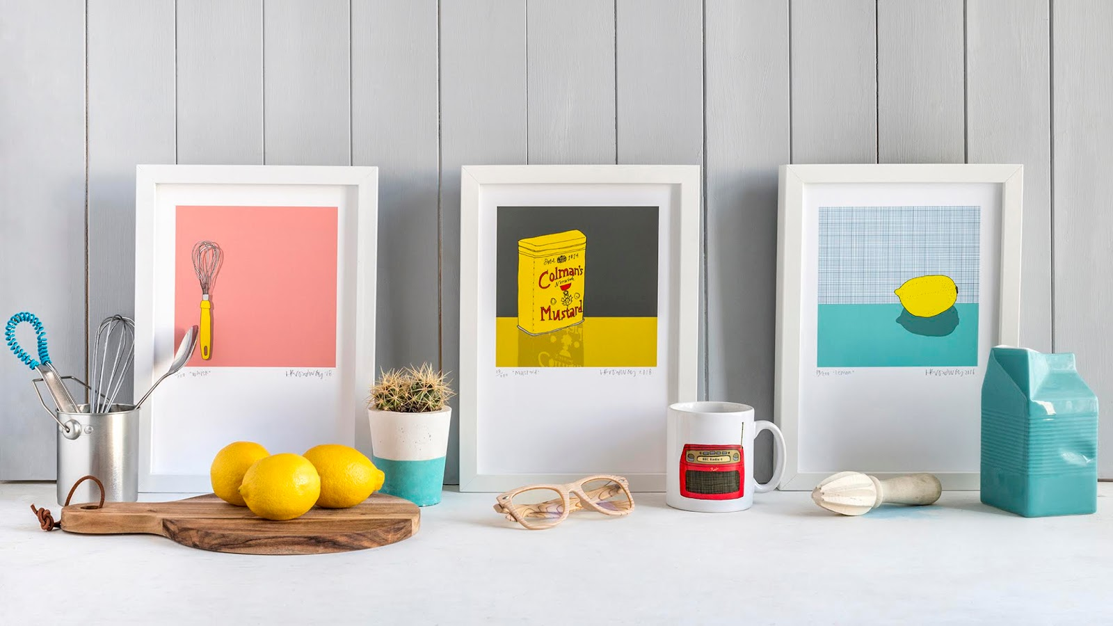 Three framed A4 prints: whisk, mustard and a lemon by Hannah Broadway