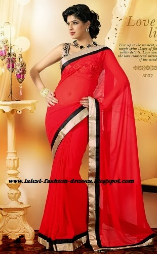 RED COLOUR SAREE WITH GOLD SLEEVELESS BLOUSE