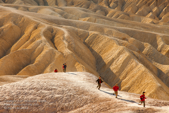a photo of children running through the badlands at zabriskie point