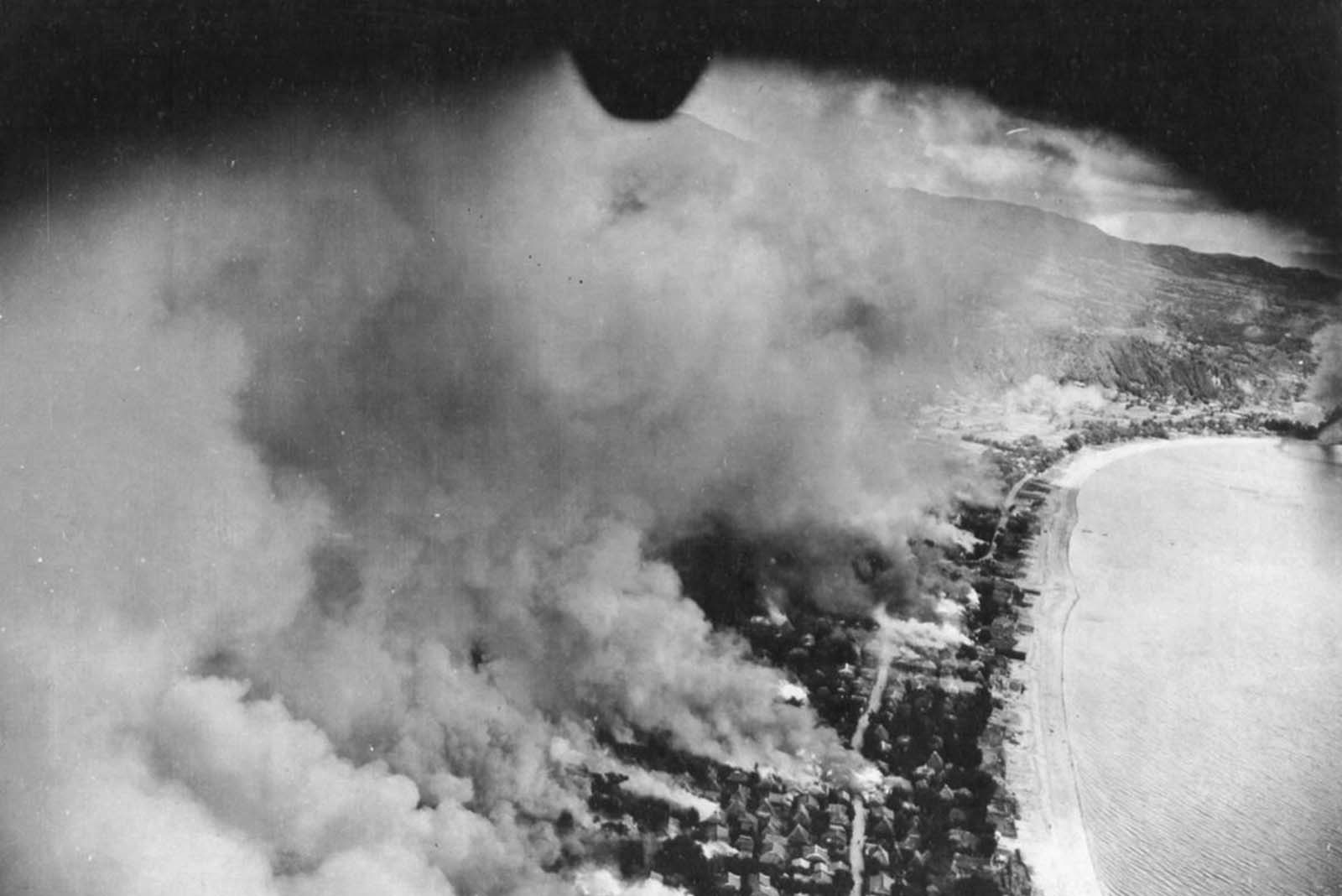 Flames spread through the city of Tarumiza, Kyushu, Japan, after incendiary bombing by the 499th Bomb Squadron, 345th Bomb Group.