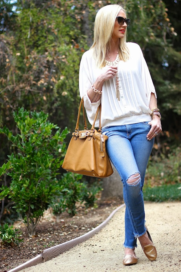 Cream top with cutoff denim pants