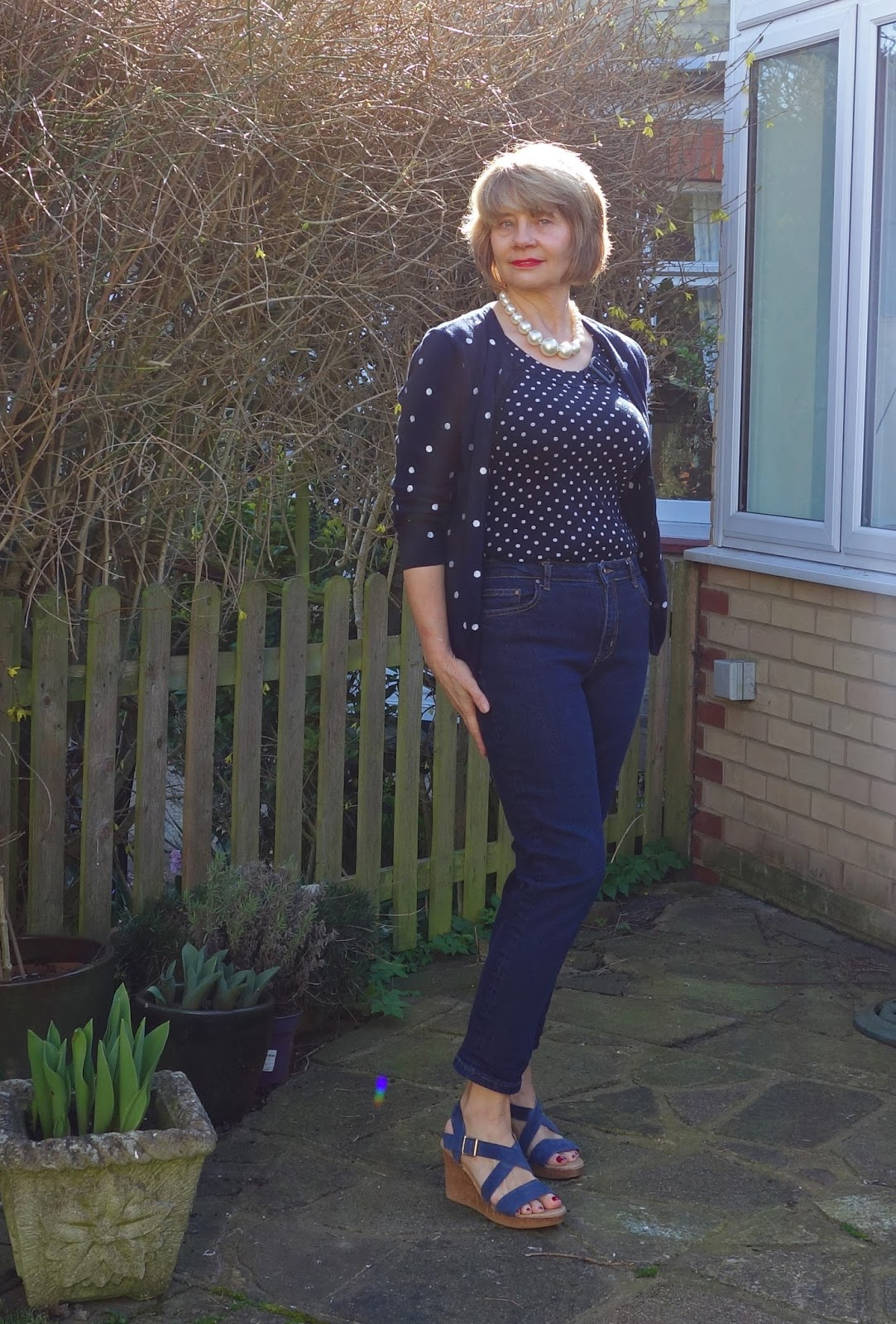 Image showing navy outfit with polka dots, jeans and pearls