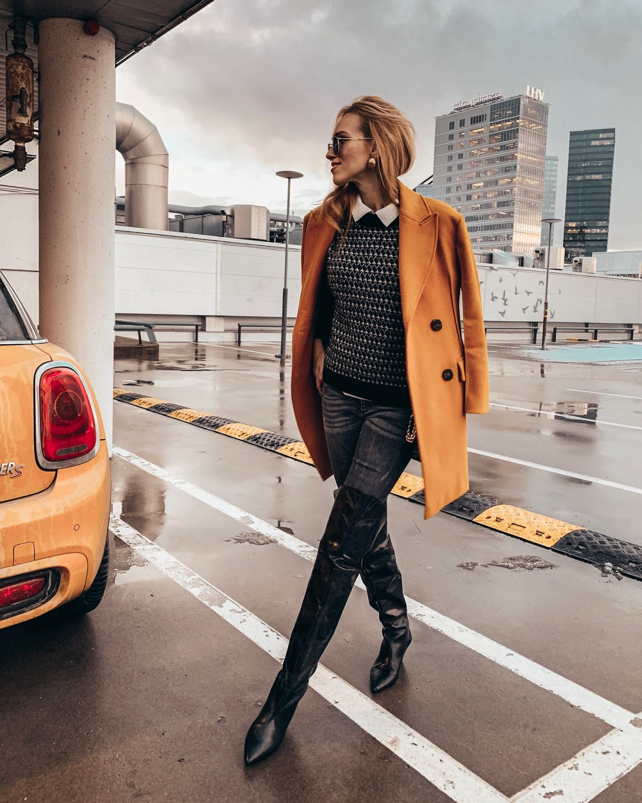 yellow wool coat over knee leather boots black sweater jeans winter outfit