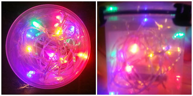 Multicolour battery operated fairy lights in a round container.