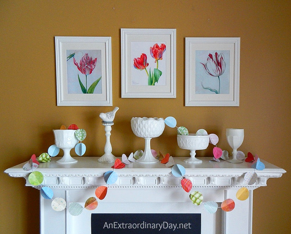 White mantel with spring inspired banner.