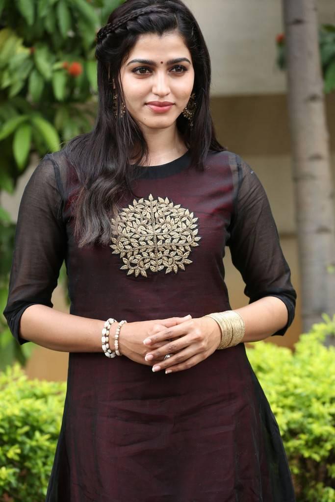 Dhanshika hot looking in maroon dress