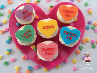 http://birdonacake.blogspot.com/2012/01/conversation-heart-cupcake-toppers.html