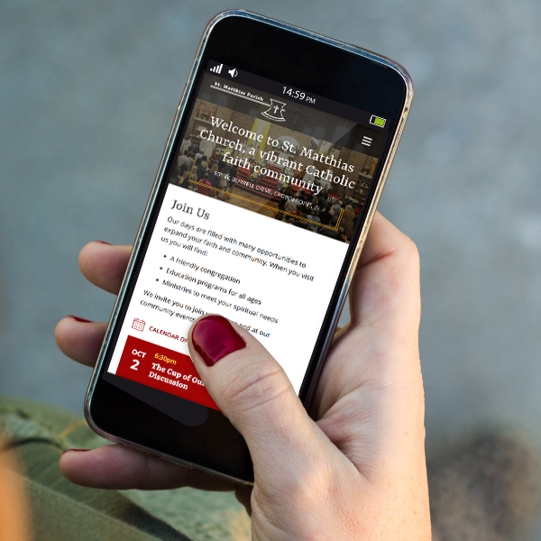 a parishioner checks the St. Matthias homepage using her smartphone to get details about an upcoming event at the church