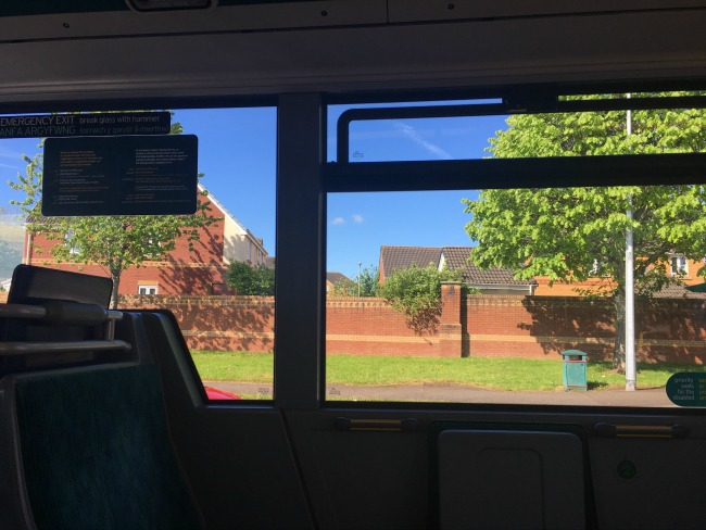 Our-weekly-journal-8th-May-view-through-bus-window-of-house-in-the-sunshine