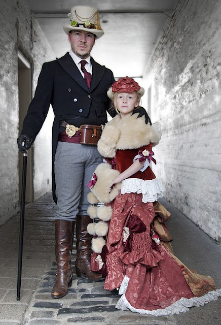 Father and daughter dressed in victorian clothing with steampunk accessories. men's steampunk fashion.