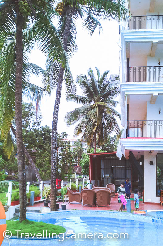 I am very late in sharing this post about our stay at Golden Tulip Hotel in Goa. Recently, I started getting few queries about Goa and I realized that post on hotel review is still pending. We stayed in this property 3 years back, which is located in Candolim area of North Goa. Choosing a hotel was a task and especially when you get lot of lucrative options in off season :).In off season you get great deals of most of the hotels in Goa and getting booking in good hotels becomes very easy & cost effective. 5 star properties in south goa offer great deals and hotels in north goa have relatively less lucrative options. This was my first visit, so after consulting fellow bloggers and friends I planned to stay in North Goa and hence chose Golden Tulip hotel in Candolim. This was the time when I wrote about the trick online booking portals play by shaowing false inventory and stale pricing. And I am talking about MakeMyTripWhile booking a room in Goa, most of the hotels and resorts have different tariffs for rooms facing pool. And after reaching Goa, I realized that location of room doesn't really matter, because you are hardly at hotel. It's just a place to spend nights.Ours was a deluxe room at Golden Tulip and it was spacious with double bed, a sofa, chair and table. There was appropriate space to walk and a fridge & cupboards on other side.We stayed here for 5 days and we always got our room is good condition. Whenever we went out, room was properly setup by the staff. Breakfast was part of the deal, which you mostly get in almost all good hotels. Variety and quality of breakfast was good.Golden Tulip is not near to the beach, if that's one of your main criteria. But it's not too far and you may not want to go to same beach again n again. While booking, we think that a beach should be nearby, so that we can get up early in the morning  and have a walk. If that's the reason, Golden Tulip is at reasonable distance. But fact is that we never got up early in morning and want for a walk. For that you need to have a property which is just on the beach.Lemon Tree is comparatively closer to the Candolim beach. Fortune Select Regina is nearby Golden Tulip and looked like a good place. We didn't go inside, but reception looked much better that Golden Tulip :). But that doesn't really mean that rooms, service and food is better. Let's not get into useless details. It remained in my mind, so shared here.Service at Golden Tulip was ok, which essentially means that it was neither fast nor pathetic. Restaurant on ground floor is running all the time, although they don't offer everything in menu during off season. We had breakfast there everyday (because it was included in the deal :) ) and apart from that we had dinner once. Our overall experience was good but food was expensive as compared some of the good restaurants available in Candolim. There are few interesting restaurants across the road, near Lemon Tree. Most of these would be open at around 8/8:30pm.At Candolim beach, there is restaurant called Sunrise which serves awesome sea food and we loved their pron biryani. They also serve liquor. So you can stay at the beach a little late, have dinner at this restaurant and come to your hotel. We did it twice. This was only place open on Candolim beach during the month of August.Overall our stay was good at Golden Tulip and here are our ratings for the property