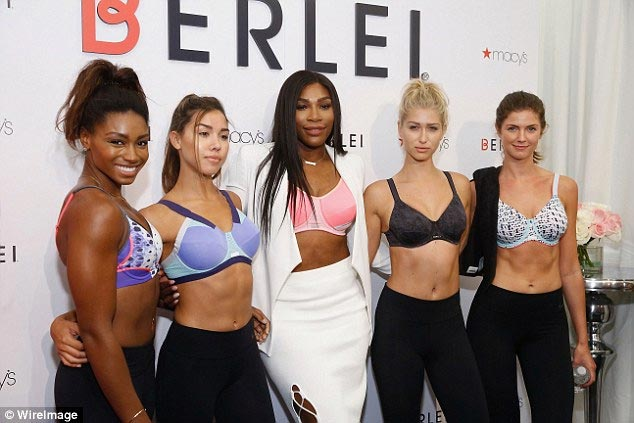 Sexy or trashy? Serena Williams bares her pink bra at lingerie launch in New York