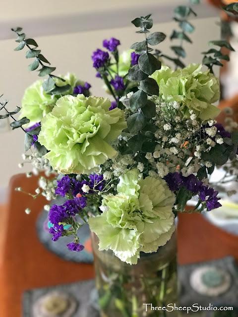 Lime green, royal purple and fresh Eucalyptus flower arrangement